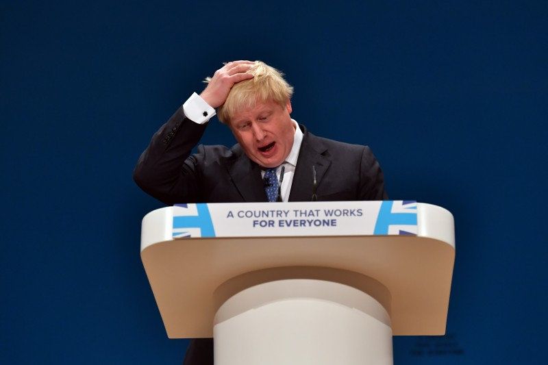 BIRMINGHAM, ENGLAND - OCTOBER 02:  Foreign Secretary Boris Johnson puts his hand to his head as he delivers a speech about Brexit on the first day of the Conservative Party Conference 2016 at the ICC Birmingham on October 2, 2016 in Birmingham, England. On the opening day of the annual party conference, British Prime Minister Theresa May has confirmed that the deadline for triggering Article 50 of the Lisbon Treaty will be the end of March 2017.  (Photo by Carl Court/Getty Images)