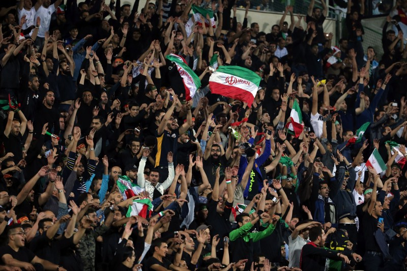 Iran's supporters celerbate their opening goal during the 2018 World Cup qualifying football match between Iran and South Korea at the Azadi Stadium in Tehran on October 11, 2016. / AFP / ATTA KENARE        (Photo credit should read ATTA KENARE/AFP/Getty Images)