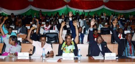 "Members of Burundi's National Assembly raise their arm to vote on October 12, 2016 in Bujumbura, for the withdrawal of the International Criminal Court (ICC) from the capital, after the UN began an enquiry into human rights abuses in the turbulent nation. The draft law was passed with 94 votes in favour, two against and 14 abstentions. It will next go to the Senate -- also dominated by the ruling party -- before being approved by President Pierre Nkurunziza. In April, ICC prosecutor Fatou Bensouda said she was conducting a ""preliminary examination"" of the situation in Burundi -- the first step towards a full investigation and possible prosecutions -- looking into allegations including murder, torture, rape and forced disappearances. / AFP / ONESPHORE NIBIGIRA        (Photo credit should read ONESPHORE NIBIGIRA/AFP/Getty Images)"