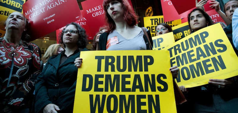 NEW YORK, NY - OCTOBER 17: Activists rally during a protest against Republican presidential candidate Donald Trump for his 'treatment of women' in front of Trump Tower on October 17, 2016 in New York City. Multiple women have come forward recently alleging sexual misconduct against Trump. Trump has denied all allegations. (Photo by Drew Angerer/Getty Images)