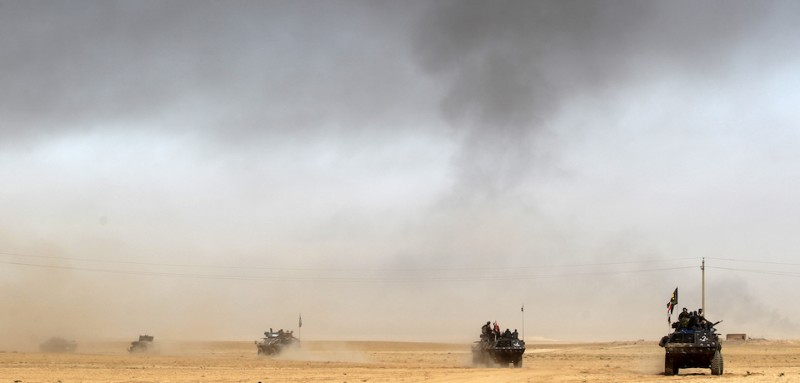 Iraqi forces deploy on October 17, 2016 in the area of al-Shurah, some 45 kms south of Mosul, as they advance towards the city to retake it from the Islamic State (IS) group jihadists. Some 30,000 federal forces are leading the offensive, backed by air and ground support from a 60-nation US-led coalition, in what is expected to be a long and difficult assault on IS's last major Iraqi stronghold.   / AFP / AHMAD AL-RUBAYE        (Photo credit should read AHMAD AL-RUBAYE/AFP/Getty Images)