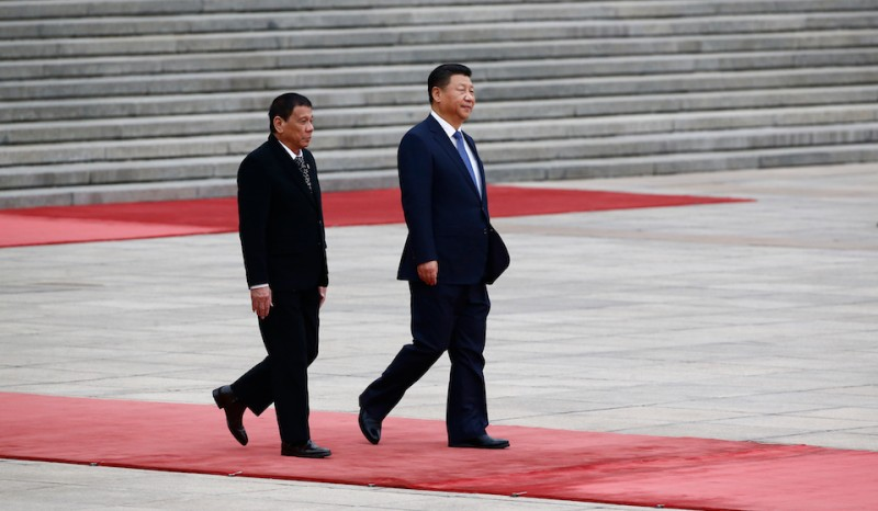 BEIJING, CHINA - OCTOBER 20: President of the Philippines Rodrigo Duterte (L) and Chinese President Xi Jinping (R) attend a welcoming ceremony at the Great Hall of the People on October 20, 2016 in Beijing, China. Philippine president Rodrigo Duterte is on a four-day state visit to China, his first since taking power in late June, with the aim of improving bilaterial relations.  (Photo by Thomas Peter-Pool/Getty Images)