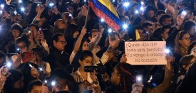 TOPSHOT - People light their cellphones during a march for peace in Bogota, on October 20, 2016. Colombian President Juan Manuel Santos, winner of this year's Nobel Peace Prize for struggling to implement a peace accord with the Revolutionary Armed Forces of Colombia (FARC) after it was rejected by voters, will visit Northern Ireland in November to learn about its peace process, the Colombian embassy said.  / AFP / Guillermo LEGARIA        (Photo credit should read GUILLERMO LEGARIA/AFP/Getty Images)