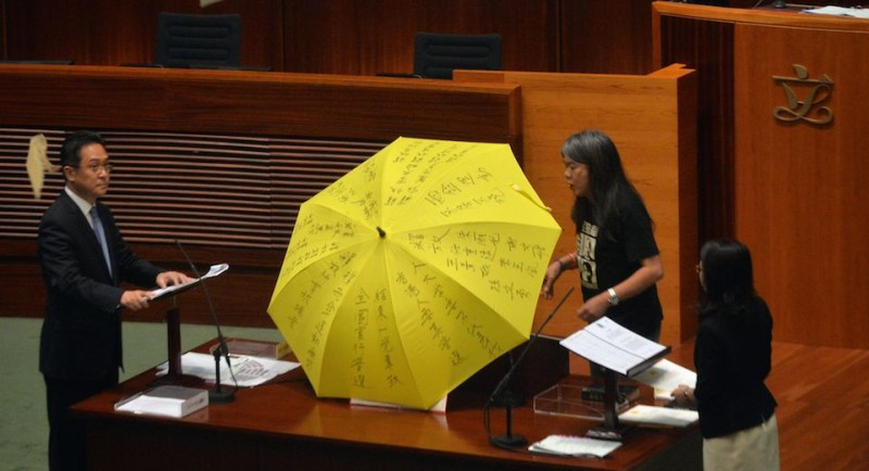 "TOPSHOT - Leung Kwok-hung (C) - known as ""Long Hair"" - of the League of Social Democrats shouts slogans and rips up the ""831 ruling"" before taking the Legislative Council Oath at the first meeting of the Sixth Legislative Council (Legco) in Hong Kong on October 12, 2016. / AFP / ANTHONY WALLACE        (Photo credit should read ANTHONY WALLACE/AFP/Getty Images)"