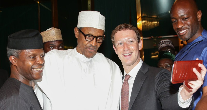 Nigerian President Muhammadu Buhari (C) and Vice President Yemi Osinbajo (L) pose as Facebook founder Mark Zuckerberg (2nd R) makes a selfie picture with them, during a visit to the presidential palace in Abuja, on September 2, 2016.  Nigerian President Muhammadu Buhari on September 2 praised Facebook founder Mark Zuckerberg for inspiring young entrepreneurs during his surprise visit to the west African country this week, his office said. Zuckerberg who arrived in Nigeria on Tuesday and has met with young entrepreneurs at information technology and computer centres in the country's commercial hub of Lagos and the capital Abuja.  / AFP / SUNDAY AGHAEZE        (Photo credit should read SUNDAY AGHAEZE/AFP/Getty Images)