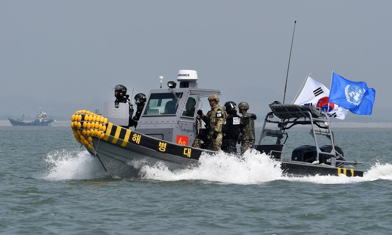 GANGHWA, SOUTH KOREA - JUNE 10:  In this handout photo provided by the South Korean Defense Ministry, South Korean marines and navy soldiers on a boat conduct a crackdown against China's illegal fishing in neutral waters on June 10, 2016 in Ganghwa island, South Korea. South Korea sent military vessels on Friday to chase away about 10 illegal Chinese fishing boats in neutral water around South Korea's Ganghwa island, based on reports.   (Photo by South Korean Defense Ministry via Getty Images)