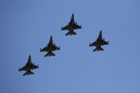 """AVONDALE, AZ - MARCH 04:  Four F-16's, 310th FS, """"Top Hats""""  fly over during the national anthem before the NASCAR Sprint Cup Series SUBWAY Fresh Fit 500 at Phoenix International Raceway on March 4, 2012 in Avondale, Arizona.  (Photo by Christian Petersen/Getty Images)"""