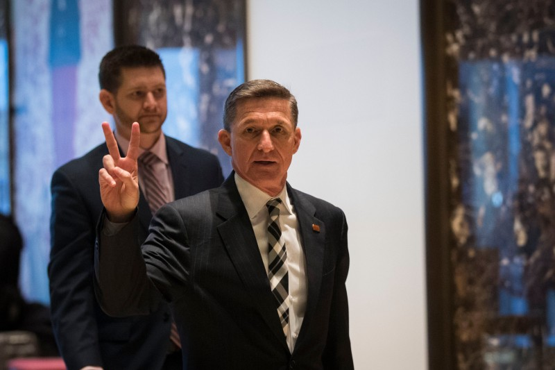 NEW YORK, NY - NOVEMBER 17: Retired Lt. Gen. Michael Flynn gestures as he arrives at Trump Tower, November 17, 2016 in New York City. President-elect Donald Trump and his transition team are in the process of filling cabinet and high level positions for the new administration. (Photo by Drew Angerer/Getty Images)