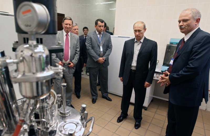 Russia's Prime Minister Vladimir Putin (2R), Russia's Deputy Prime Minister Sergei Ivanov (L) and governor of the Moscow Region Boris Gromov visit the Gazprom (VNIIGAZ) Scientific and Research Institute of Natural Gases and Gas Technologies outside Moscow on August 3, 2010. AFP PHOTO / RIA NOVOSTI / POOL / ALEXEY DRUZHININ (Photo credit should read ALEXEY DRUZHININ/AFP/Getty Images)
