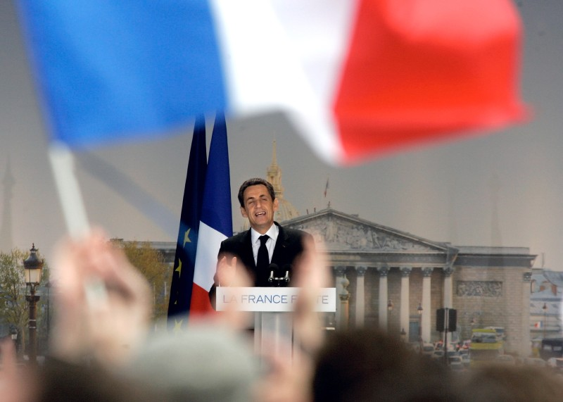 PARIS, FRANCE - APRIL 15:  French President and right-wing ruling party, Union for a Popular Movement (UMP) candidate for the French 2012 presidential election Nicolas Sarkozy delivers a speech during a campaign meeting at Place de la Concorde on April 15, 2012 in Paris, France. President Sarkozy and challenger Socialist Francois Hollande held giant campaign rallies a week before the first round of voting as polls showed Hollande widening his lead by another two points.  (Photo by Franck Prevel/Getty Images)
