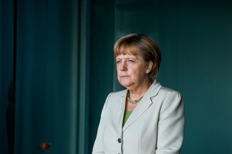 BERLIN, GERMANY - AUGUST 28: German Chancellor Angela Merkel waits for delegates at the German government Balkan conference at the Chancellery on August 28, 2014 in Berlin, Germany. The leaders of Albania, Kosovo, Croatia, Bosnia-Herzegovina, Slovenia, Serbia, Montenegro and Macedonia are participating in the conference that also includes Austrian Chancellor Werner Faymann and European Commission President Jose Manuel Barroso. (Photo by Jochen Zick - Pool / Getty Images)