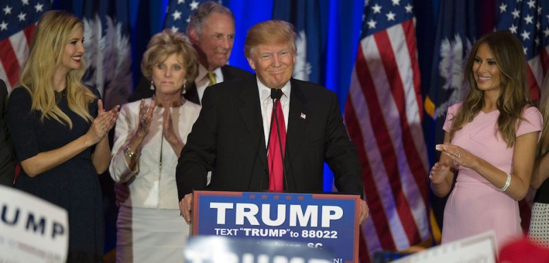 TOPSHOT - Republican presidential candidate Donald Trump celebrates winning the South Carolina primary in Spartanburg, South Carolina, February 20, 2016.  Republican presidential frontrunner Donald Trump grabbed a big win in the South Carolina primary on February 20, 2016. The 69-year-old Trump captured about a third of the votes, according to early counts, but all major networks projected he was the winner. / AFP / JIM WATSON        (Photo credit should read JIM WATSON/AFP/Getty Images)