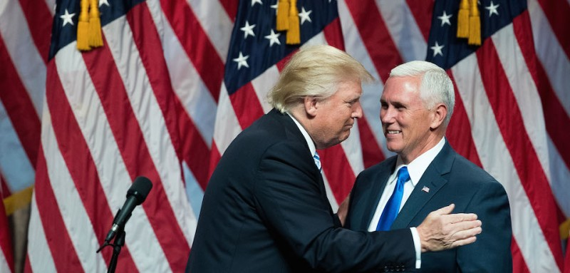 NEW YORK, NY - JULY 16: (L to R) Republican presidential candidate Donald Trump greets his newly selected vice presidential running mate Mike Pence, governor of Indiana, as he takes the stage during an event at the Hilton Midtown Hotel, July 16, 2016 in New York City. On Friday, Trump announced on Twitter that he chose Pence to be his running mate. (Photo by Drew Angerer/Getty Images))