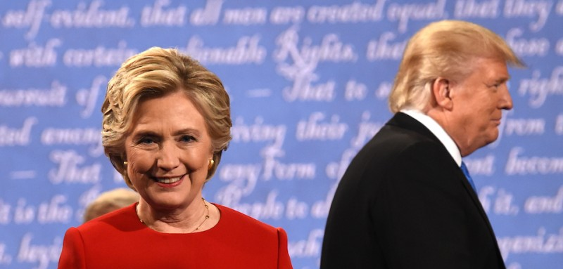TOPSHOT - Democratic nominee Hillary Clinton (L) and Republican nominee Donald Trump leave the stage after the first presidential debate at Hofstra University in Hempstead, New York on September 26, 2016. / AFP / Timothy A. CLARY        (Photo credit should read TIMOTHY A. CLARY/AFP/Getty Images)
