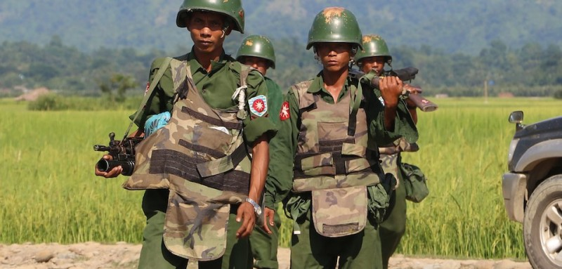 In this photograph taken on October 21, 2016, armed Myanmar soldiers patrol a village in Maungdaw located in Rakhine State as security operation continue following the October 9, 2016 attacks by armed militant Muslim.  The United Nations called for an investigation into claims Myanmar troops have been killing civilians and torching villages in northern Rakhine, as reports emerged thousands of Rohingya had been forced from their homes. / AFP / STR        (Photo credit should read STR/AFP/Getty Images)
