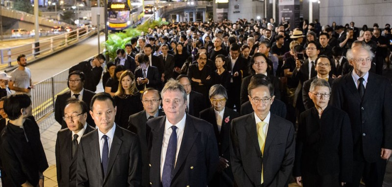 (Front L-R) Members from the legal sector, including former lawmaker Audrey Eu, lawmaker Dennis Kwok, senior counsel Graham Harris, former lawmaker Martin Lee, senior counsel Gladys Li and solicitor John Clancey, join other lawyers and law students in a silent march in protest at a ruling by China which effectively bars two pro-independence legislators from taking office in Hong Kong on November 8, 2016.   Hundreds of lawyers and law students, all dressed in black, marched silently through Hong Kong on November 8 in protest at a ruling by China which effectively bars two pro-independence legislators from taking office. / AFP / Anthony WALLACE        (Photo credit should read ANTHONY WALLACE/AFP/Getty Images)