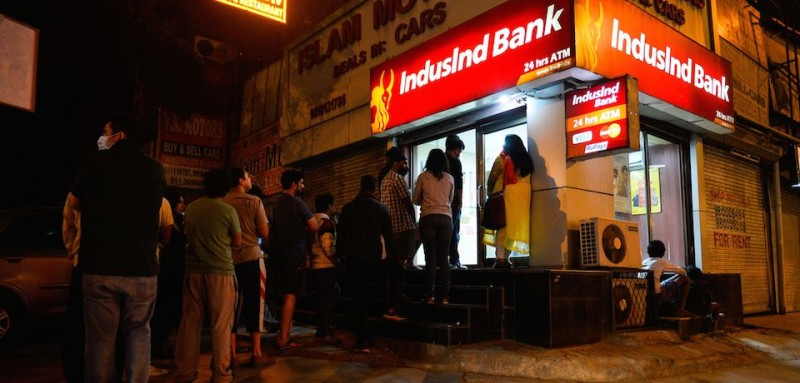 "Indian residents queue to try to withdraw money from an ATM in New Delhi on November 8, 2016. Indian Prime Minister Narendra Modi announced late November 8 that 500 and 1,000 ($15) rupee notes will be withdrawn from financial circulation from midnight, in a bid to tackle corruption. ""To break the grip of corruption and black money, we have decided that the 500 and 1,000 rupee currency notes presently in use will no longer be legal tender from midnight ie 8 November, 2016,"" Modi said in a special televised address to the nation. / AFP / CHANDAN KHANNA        (Photo credit should read CHANDAN KHANNA/AFP/Getty Images)"