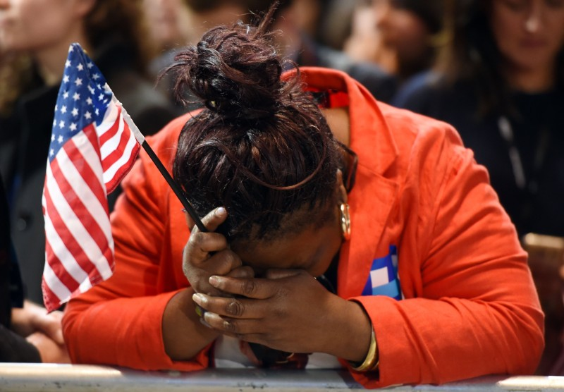 TOPSHOT - Marta Lunez, supporter of US Democratic presidential nominee Hillary Clinton, reacts to elections results during election night at the Jacob K. Javits Convention Center in New York on November 8, 2016.  / AFP / DON EMMERT        (Photo credit should read DON EMMERT/AFP/Getty Images)