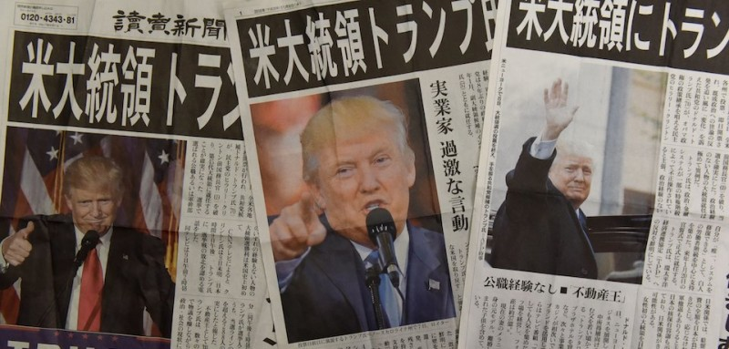 This photo illustration shows extra editions of Japanese newspapers reporting the victory of Donald Trump in the US presidential election in Tokyo on November 9, 2016.   Japanese Prime Minister Shinzo Abe congratulated Trump on November 9 on his election as US president and vowed that the countries will maintain their close relationship. / AFP / TORU YAMANAKA        (Photo credit should read TORU YAMANAKA/AFP/Getty Images)