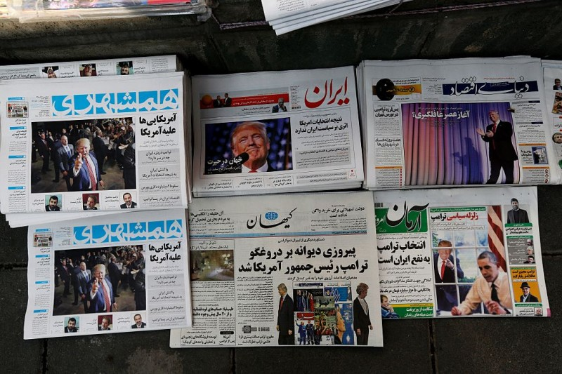 "A picture taken on November 10, 2016 in the Iranian capital Tehran shows local newspapers displaying articles on US president-elect Donald Trump a day after his election. Iran's President Hassan Rouhani said on November 9 there was ""no possibility"" of its nuclear deal with world powers being overturned by US president-elect Donald Trump despite his threat to rip it up.   / AFP / ATTA KENARE        (Photo credit should read ATTA KENARE/AFP/Getty Images)"