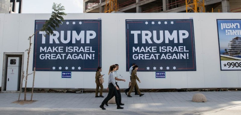 "Placards reading in english "" Trump Make Israel Great Again "" are seen in the Israeli coastal city of Tel Aviv, on November 15, 2016. US president-elect Donald Trump pledged to work for a ""just, lasting peace"" between Israel and the Palestinians, in his first public message on the issue since his upset victory.  / AFP / JACK GUEZ        (Photo credit should read JACK GUEZ/AFP/Getty Images)"