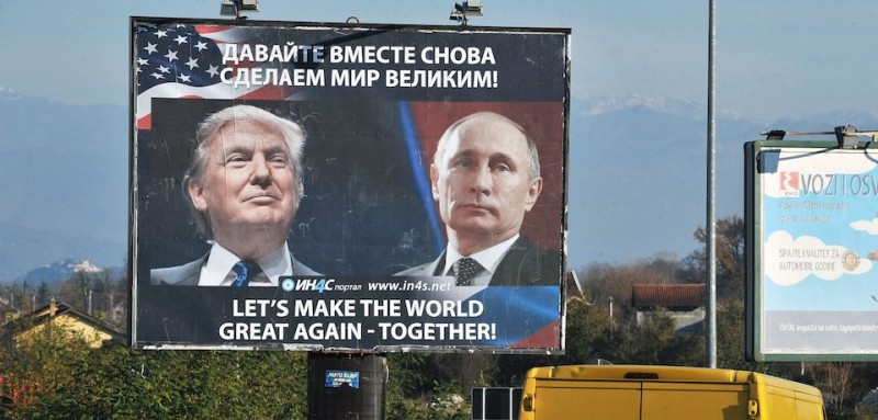 Cars pass by a billboard showing US President-elect Donald Trump and Russian President Vladimir Putin placed by pro-Serbian movement in the town of Danilovgrad on November 16, 2016.   Russian President Vladimir Putin and Donald Trump spoke on the phone on November 15, evening and agreed on the need to normalise ties between Washington and Moscow, the Kremlin said.       / AFP / Savo PRELEVIC        (Photo credit should read SAVO PRELEVIC/AFP/Getty Images)