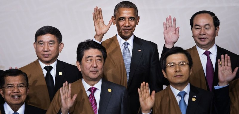 "(L to R back) Thailand's Deputy Prime Minister Prajin Juntong, US President Barack Obama and Vietnam's President Tran Dai Quang; (L to R front) Indonesia's Vice President Jusuf Kalla, Japan's Prime Minister Shinzo Abe and South Korea's Prime Minister Hwang Kyo-Ahn wave during the traditional ""family photo"" on the final day of the Asia-Pacific Economic Cooperation (APEC) Summit at the Lima Convention Centre in Lima on November 20, 2016.      Asia-Pacific leaders are expected to send a strong message in defense of free trade as they wrap up a summit that has been overshadowed by US President-elect Donald Trump's protectionism. / AFP / Brendan Smialowski        (Photo credit should read BRENDAN SMIALOWSKI/AFP/Getty Images)"