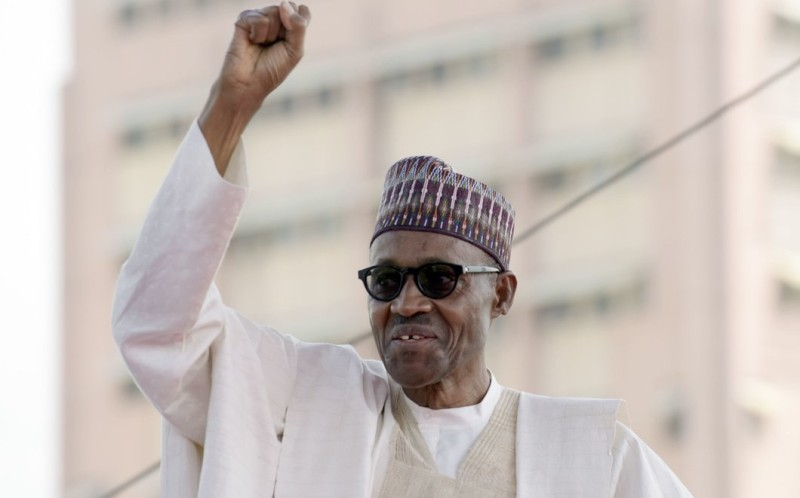 Nigerian President Mohammadu Buhari raises his fist to greet the crowd before taking oath of office at the Eagles Square in Abuja, on May 29, 2015. Buhari, 72, defeated Jonathan in March 28 elections -- the first time in Nigeria's history that an opposition candidate had beaten a sitting president. AFP PHOTO/PIUS UTOMI EKPEI / AFP / PIUS UTOMI EKPEI        (Photo credit should read PIUS UTOMI EKPEI/AFP/Getty Images)