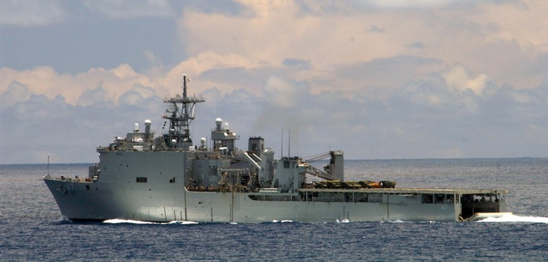 040718-N-5055W-034 Pacific Ocean (July 18, 2004) – The amphibious dock landing ship USS Rushmore (LSD 47) heads out to sea after dispatching Amphibious Assault Vehicles (AAV) during a mechanized amphibious raid in support of exercise Rim of the Pacific (RIMPAC) 2004. RIMPAC is the largest international maritime exercise in the waters around the Hawaiian Islands. This year's exercise includes seven participating nations; Australia, Canada, Chile, Japan, South Korea, the United Kingdom and the United States. RIMPAC is intended to enhance the tactical proficiency of participating units in a wide array of combined operations at sea, while enhancing stability in the Pacific Rim region. U.S. Navy photo by Photographer's Mate 1st Class Jane West (RELEASED) For more information go to: http://www.cpf.navy.mil/RIMPAC2004/
