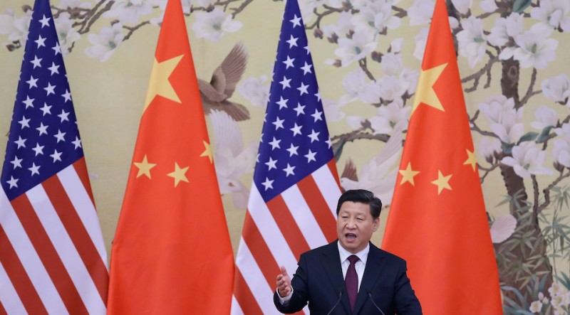 BEIJING, CHINA - NOVEMBER 12:  Chinese President Xi Jinping (R) answers media's question during a press conference with U.S. President Barack Obama at the Great Hall of People on November 12, 2014 in Beijing, China. U.S. President Barack Obama pays a state visit to China after attending the 22nd Asia-Pacific Economic Cooperation (APEC) Economic Leaders' Meeting.  (Photo by Feng Li/Getty Images)