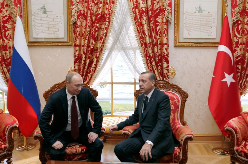 Turkey's Prime Minister Recep Tayyip Erdogan (R) speaks with Russia's President Vladimir Putin in Istanbul on December 3, 2012. Putin arrived in Istanbul on December 3 for a landmark visit due to focus on resolving differences with Turkey over the 20-month crisis in war-ravaged Syria. AFP PHOTO / POOL / TOLGA BOZOGLU        (Photo credit should read TOLGA BOZOGLU/AFP/Getty Images)