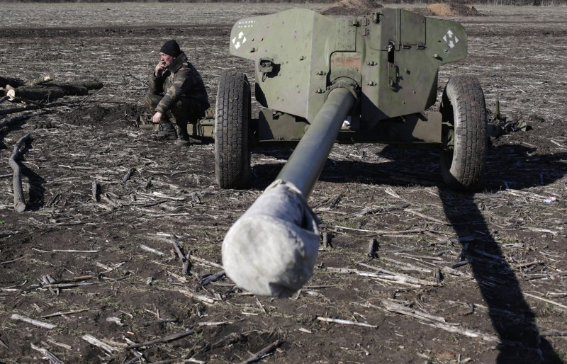 A Ukrainian serviceman smokes while manning a position near Svitlodarsk, in the Donetsk region, on February 21, 2015. The continued fighting in eastern Ukraine has made a mockery of the West's latest attempts to negotiate a ceasefire but may ultimately pave the way for a more durable peace, say analysts. AFP PHOTO/ ANATOLII STEPANOV        (Photo credit should read ANATOLII STEPANOV/AFP/Getty Images)