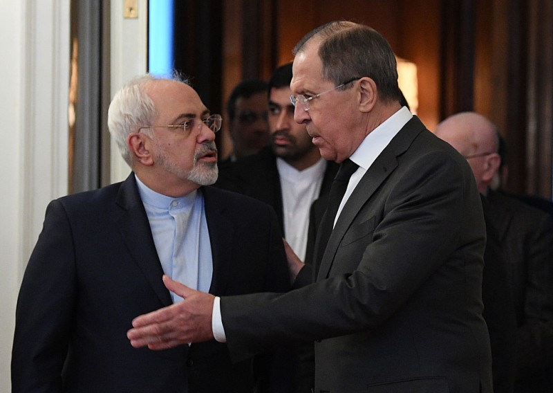 Russian Foreign Minister Sergei Lavrov (R) welcomes his Iranian counterpart Mohammad Javad Zarif (L) during their meeting in Moscow on December 20, 2016.   / AFP / Natalia KOLESNIKOVA        (Photo credit should read NATALIA KOLESNIKOVA/AFP/Getty Images)