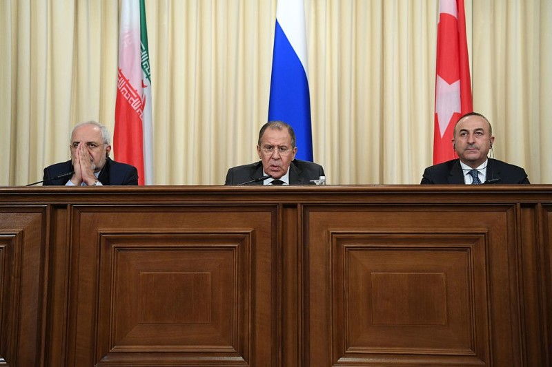 Russian Foreign Minister Sergei Lavrov (C), his Turkish counterpart Mevlut Cavusoglu (R) and Iran's Foreign Minister Mohammad Javad Zarif attend a news conference in Moscow on December 20, 2016.   The foreign and defence ministers of Russia, Turkey and Iran are meeting in Moscow for key talks on the conflict in Syria. Iran and Russia are sharing a base in war-torn Syria to help coordinate their support for President Bashar al-Assad's forces, a top security official in Tehran said on December 20.   / AFP / Natalia KOLESNIKOVA        (Photo credit should read NATALIA KOLESNIKOVA/AFP/Getty Images)