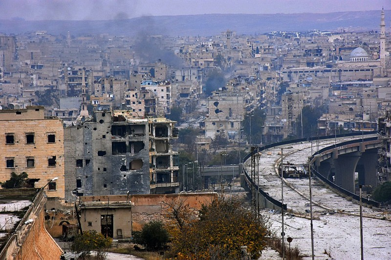 A picture taken on December 5, 2016 shows destroyed buildings in Aleppo's eastern al-Shaar neighbourhood as Syrian pro-government troops advance towards the area through Karm al-Jabal district during their offensive to retake Syria's second city. The Syrian Observatory for Human Rights said the advances of the Syrian and allied forces left the large Shaar neighbourhood encircled by government forces and in danger of falling from rebel control. With the capture of Shaar, the army would hold 70 percent of east Aleppo, four years after rebels first seized it. / AFP / GEORGE OURFALIAN        (Photo credit should read GEORGE OURFALIAN/AFP/Getty Images)