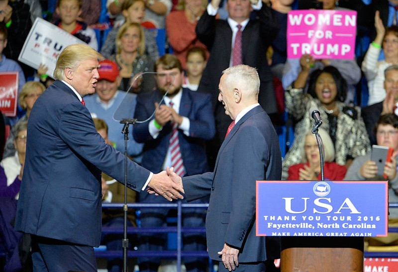 FAYETTEVILLE, NC - DECEMBER 06:  President-elect Donald Trump shakes the hand of retired U.S. Marine General James Mattis after naming him Secretary of Defense  at Crown Coliseum on December 6, 2016 in Fayetteville, North Carolina. Trump took time off from selecting the cabinet for his incoming administration to celebrate his victory in the general election. (Photo by Sara D. Davis/Getty Images)