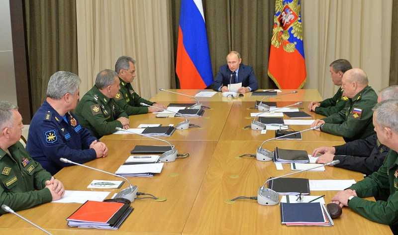 Russian President Vladimir Putin (C), accompanied by Defence Minister Sergei Shoigu (4thL), meets with military chiefs at the Bocharov Ruchei state residence in Sochi on November 16, 2016.  / AFP / SPUTNIK / ALEXEI DRUZHININ        (Photo credit should read ALEXEI DRUZHININ/AFP/Getty Images)