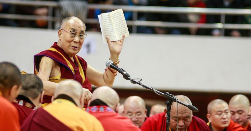 The Dalai Lama waves to worshippers during ceremonies at the Buyant Ukhaa sports stadium in Ulan Bator, the capital of Mongolia, on November 20, 2016.  The Dalai Lama is on a four-day visit to Mongolia, despite Beijing's strident demand that he be barred from entering the country. / AFP / BYAMBASUREN BYAMBA-OCHIR        (Photo credit should read BYAMBASUREN BYAMBA-OCHIR/AFP/Getty Images)