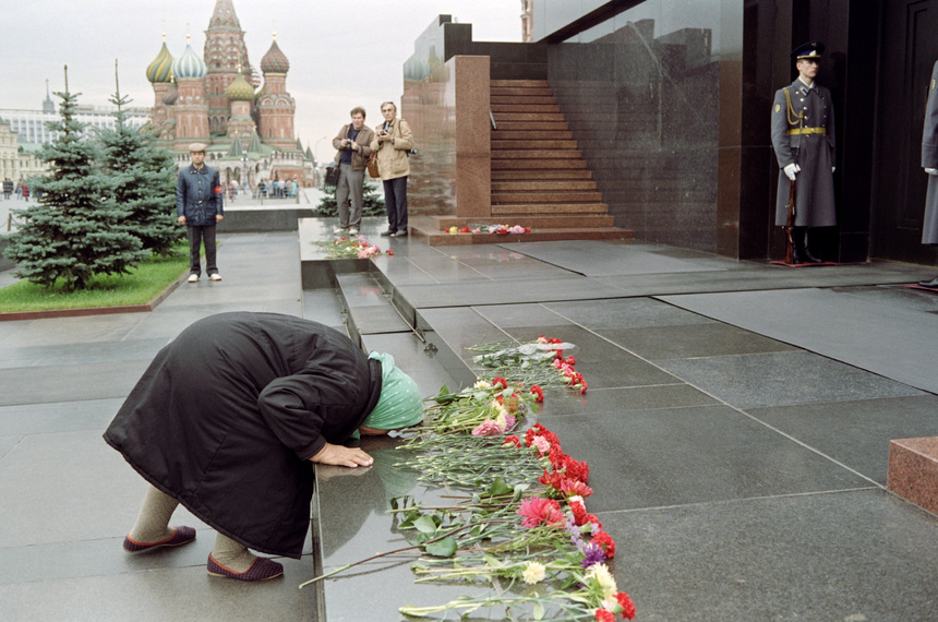 A elderly woman kisses the steps leading to the Lenin Mausoleum in Moscow's Red Square on October 5, 1991. She among a thousand other demonstrators was protesting the current desecrations of Soviet Founder Lenin's memory since the failed coup. Statues of the Soviet founder have been removed from prominent places and the Mayor of Moscow has recently said he wants to close the Lenin Museum near Red Square. AFP PHOTO VITALY ARMAND (Photo credit should read VITALY ARMAND/AFP/Getty Images)