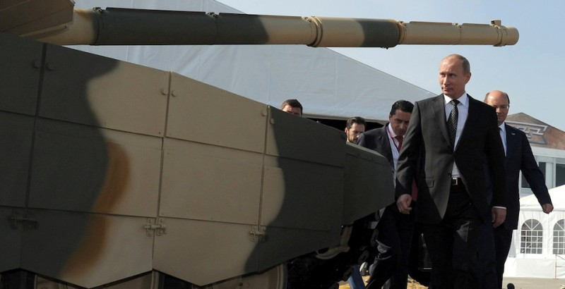 Russia's Prime Minister Vladimir Putin passes by a T-90AM tank during his visit to an arms exhibition in the Urals town of Nizhny Tagil, on September 9, 2011.  AFP PHOTO/ RIA-NOVOSTI POOL/ ALEXEY DRUZHININ (Photo credit should read ALEXEY DRUZHININ/AFP/Getty Images)