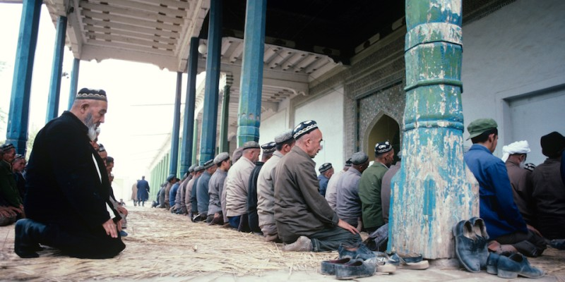 These men are praying at sunset during the holy month of Ramadan, Feb 2003.