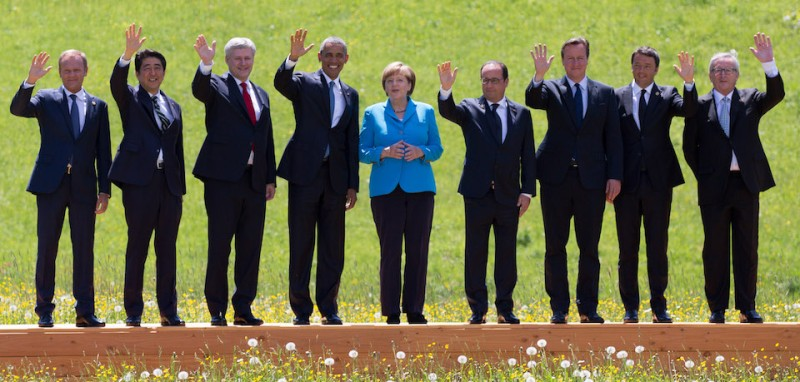 GARMISCH-PARTENKIRCHEN, GERMANY - JUNE 07:  (From L to R) President of the European Council Donald Tusk, Japanese Prime Minister Shinzo Abe, Canada's Prime Minister Stephen Harper, U.S. President Barack Obama, German Chancellor Angela Merkel, French President Francois Hollande, British Prime Minister David Cameron, Italian Prime Minister Matteo Renzi and President of the European Commission Jean-Claude Juncker pose at the group photo at the summit of G7 nations at Schloss Elmau on June 7, 2015 near Garmisch-Partenkirchen, Germany. In the course of the two-day summit G7 leaders are scheduled to discuss global economic and security issues, as well as pressing global health-related issues, including antibiotics-resistant bacteria and Ebola. Several thousand protesters have announced they will seek to march towards Schloss Elmau and at least 17,000 police are on hand to provide security.  (Photo by Carl Court/Getty Images)