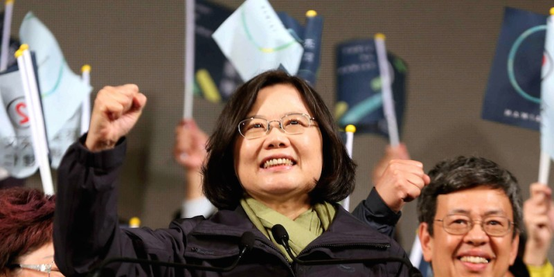 TAIPEI, TAIWAN - JANUARY 16:  (CHINA OUT, SOUTH KOREA OUT) Tsai Ing-wen (C), waves to supporters at the Democratic Progressive Party (DPP) headquarters after her election victory on January 16, 2016 in Taipei, Taiwan. Tsai Ing-wen, the chairwoman of the opposition DPP, has won the presidential election to become the Taiwan's first female president.  (Photo by The Asahi Shimbun via Getty Images)