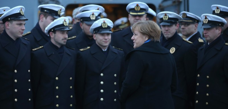 "KIEL, GERMANY - JANUARY 19:  German Chancellor Angela Merkel chats with sailors of the German Navy while she visited the ""Braunschweig"" warship on January 19, 2016 in Kiel, Germany. Merkel was visiting the ""Braunschweig,"" a small frigate of the German Navy's First Flotilla, at its home base in Kiel. The German Navy is participating in the international military coalition fighting the Islamic State (IS) in Syria.  (Photo by Sean Gallup/Getty Images)"