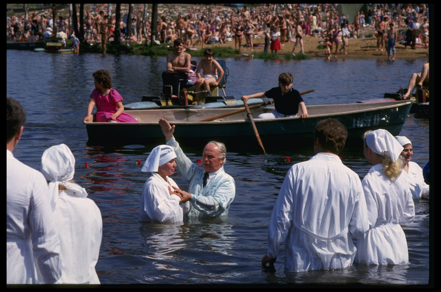 Baptism ceremony, w. some 100 believers being dunked, as religious revivalist spirit takes root, in Poklony Hills, Leningrad, USSR.  (Photo by Igor Gavrilov/The LIFE Images Collection/Getty Images)