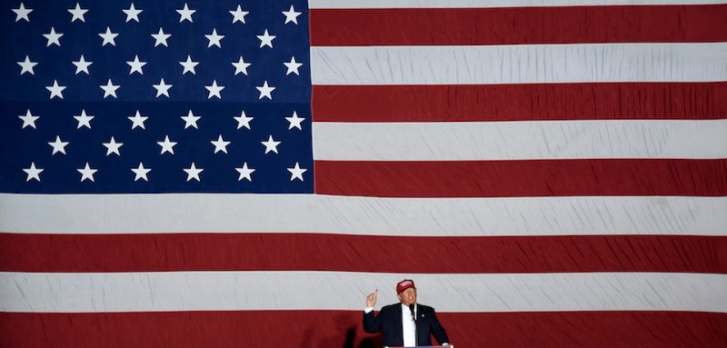 TOPSHOT - Republican presidential candidate Donald Trump speaks at a rally on March 13, 2016 in Boca Raton, Florida. Primary voters head to the polls on March 15th in Florida. / AFP / RHONA WISE        (Photo credit should read RHONA WISE/AFP/Getty Images)