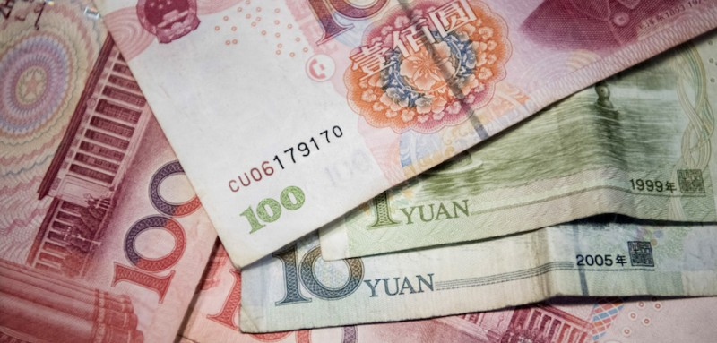 This photo illustration taken on September 29, 2016 shows Chinese 100 yuan, 10 yuan and one yuan notes in Beijing. / AFP / FRED DUFOUR        (Photo credit should read FRED DUFOUR/AFP/Getty Images)