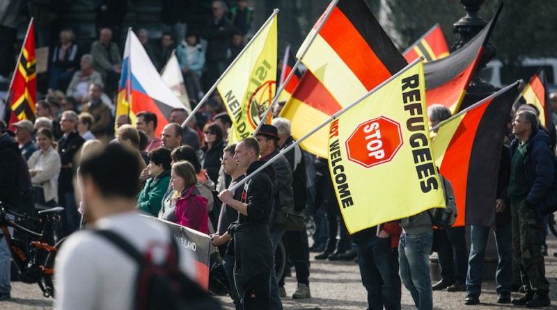 Supporters of the anti-immigrant Pegida movement (Patriotic Europeans Against the Islamisation of the Occident) mark the second year of existence as they demonstrate in Dresden, eastern Germany, on October 2016, and  Dresden, a Baroque city in Germany's ex-communist east, is the birthplace of the anti-immigration PEGIDA street movement. / AFP / dpa / Oliver Killig / Germany OUT        (Photo credit should read OLIVER KILLIG/AFP/Getty Images)