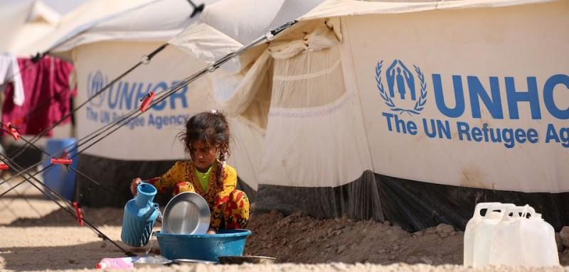 An Iraqi refugee child who fled Mosul, the last major Iraqi city under the control of the Islamic State (IS) group, due to the Iraqi government forces offensive to retake the city, washes dishes at the UN-run al-Hol refugee camp in Syria's Hasakeh province, on October 31, 2016. At Al-Hol, the camp is being expanded to accommodate the refugees already arriving and the many more who are expected to come as the operation to recapture Mosul advances. Some 6,000 people have been at the camp for around the last two years, and it is being expanded to receive 30,000 people.    / AFP / DELIL SOULEIMAN        (Photo credit should read DELIL SOULEIMAN/AFP/Getty Images)