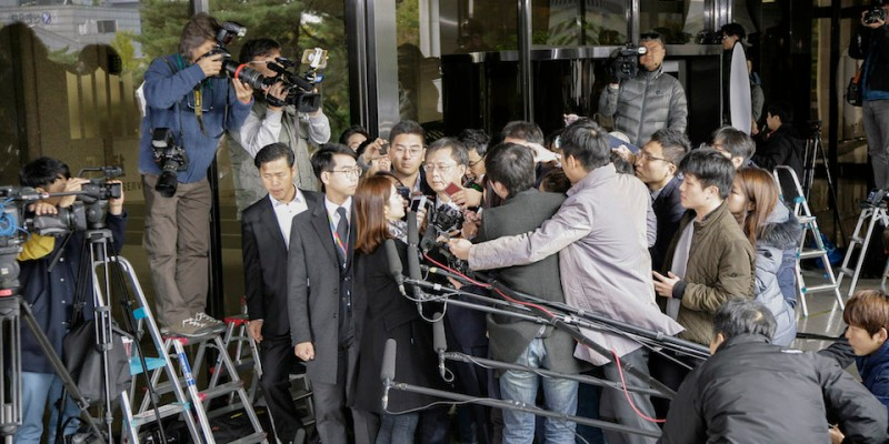 South Korean President  former senior secretary for civil affairs Woo Byung-woo standing answer to reporters question before allegations at Seoul prosecutor office in Seoul, South Korea. President Park Geun-hye's former senior secretary for civil affairs appeared before the prosecution for questioning over a string of corruption allegations on Sunday, becoming the second ex-presidential aide to face a probe. The state prosecution's special investigation team summoned Woo Byung-woo, who has been accused of the alleged abuse of authority and embezzlement. (Photo by Seung-il Ryu/NurPhoto via Getty Images)